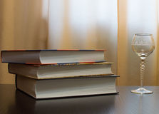 Empty glass and closed books Royalty Free Stock Image