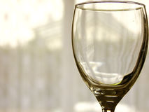Empty Glass closeup. Closeup of one empty Glass in front of Window Royalty Free Stock Image