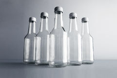 Empty glass cocoktail bottle with white cap mockup set Royalty Free Stock Photos