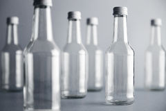 Empty glass cocoktail bottle with white cap mockup set Royalty Free Stock Photography