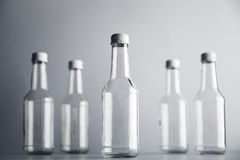Empty glass cocoktail bottle with white cap mockup set Stock Photography