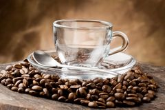 Empty Glass Cup on Coffee Beans Stock Photo