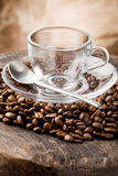 Empty Glass Cup on Coffee Beans Stock Photography