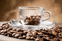 Empty Glass Cup on Coffee Beans Royalty Free Stock Photos