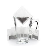 Empty glass cup and tea bags Stock Images