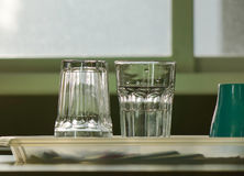 Empty glass cups on table in kitchen Stock Photography
