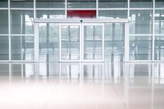 Empty glass door in office building. With copy space royalty free stock image