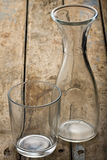 Empty Glass and Glass Jug stock image