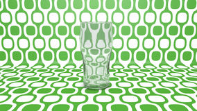 Empty glass  on green. Empty glass isolates on abstract green background Stock Image