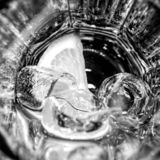 empty glass with ice and lemon stock image