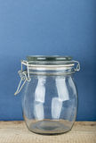 Empty glass jar with cap hold with metal wire Stock Images