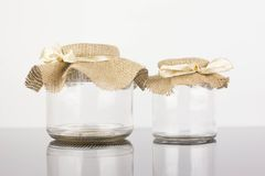 Empty glass jar with packaging sacking Royalty Free Stock Image