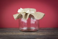 Empty glass jar with packaging sacking Royalty Free Stock Photography