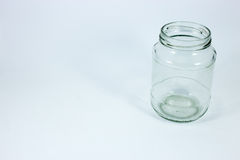 Empty glass jar  on a white background Royalty Free Stock Photo