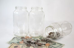 Empty glass jars and money Royalty Free Stock Image
