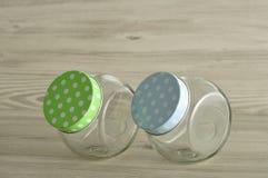 Empty glass jars with polka dot lids Royalty Free Stock Photos