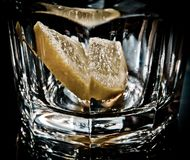 Empty glass with lemon Royalty Free Stock Photo