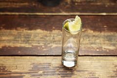 Empty glass with lemon Royalty Free Stock Image