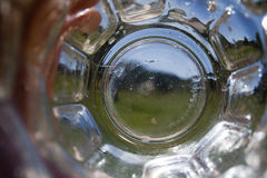Empty Glass. Looking through an empty glass on a summer day Stock Photography