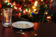 empty glass from milk and crumbs from cookies for Santa Claus un stock photos