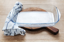 Empty glass pan on wooden Stock Image