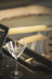 Empty glass on a piano. An empty wine glass on a piano after a classical concert. Focus on the glass Stock Photo