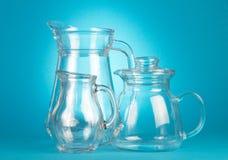 Empty glass pitchers Stock Photo