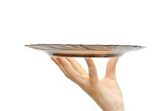 Empty glass plate in a female hand Royalty Free Stock Image