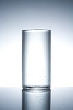 Empty glass on a reflecting surface Stock Images