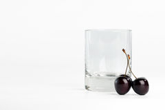 Empty glass and sweet  cherry Royalty Free Stock Image