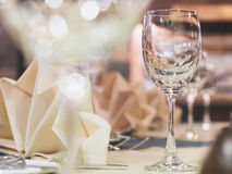 Empty glass on table with dining set Royalty Free Stock Images