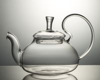 Empty glass teapot on a gray background royalty free stock images