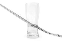 Empty glass tied with measuring tape Stock Photo