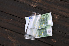 Empty Glass and Two One Hundred Euro Banknotes Stock Photography