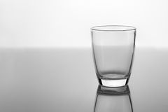 Empty glass for water, juice or milk on white background grey fl Royalty Free Stock Images