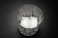 Empty glass of whiskey with ice Stock Image