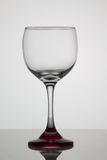 Empty glass of wine on white background stock photos