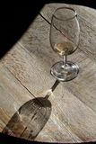 Empty glass on wooden table Stock Photos