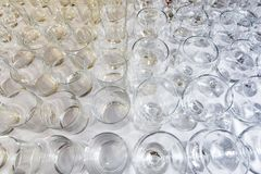 Empty glasses arranged in rows top view royalty free stock photos