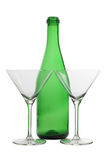 Empty glasses beakers and green bottle Royalty Free Stock Image