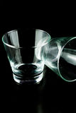 Empty glasses on a black background Stock Photos