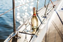 Empty glasses and bottle with champagne with sea background royalty free stock images