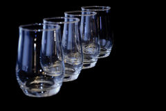 Empty glasses in a diagonal row - horizontal Stock Photo