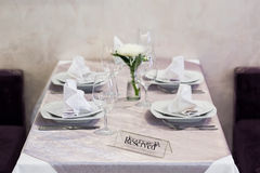 Empty glasses and dishes set in an interior new luxury restaurant with covered tables Royalty Free Stock Photography