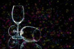 Empty glasses fading lights Royalty Free Stock Photo