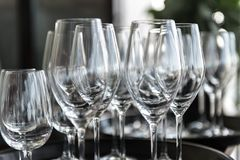 Empty glasses on platters with blurred background stock images
