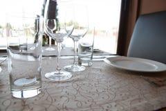 Empty glasses in restaurant Stock Images