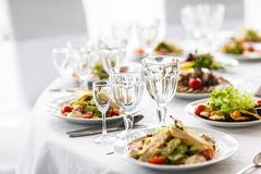 Empty glasses  in restaurant. Banquet table set. Empty glasses set in restaurant. Banquet table set Royalty Free Stock Image