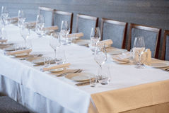 Empty glasses in restaurant. Cutlery on the table in a restaurant table setting, knife, fork, spoon, interior. Stock Photos