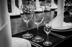 Empty glasses in restaurant. Black and white photography Royalty Free Stock Images